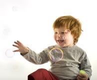 Little boy soap bubbles Stock Photography