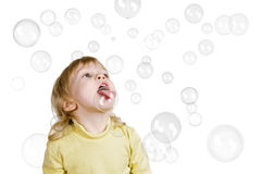 Little boy and soap bubbles Stock Images