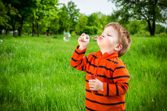 Little boy with soap bubbles Stock Image