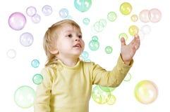 Little boy and soap bubbles Stock Photos