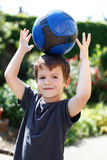 Little boy with soccer ball on head Royalty Free Stock Image