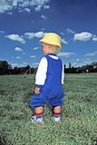 Lonely Little Boy in Soccer Field Stock Photos