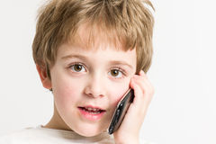 Little Boy Speaking at the Phone Royalty Free Stock Photo