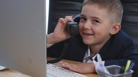 Little boy speaking on phone in the office Stock Photography
