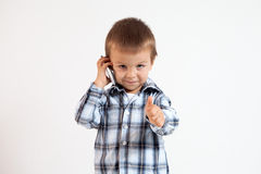 Little boy, speaking on the phone. Thumbs up Royalty Free Stock Image