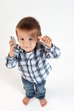 Little boy, speaking on the phone. Thumbs up Royalty Free Stock Photos
