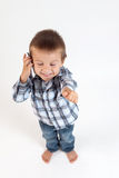 Little boy, speaking on the phone. Thumbs up Stock Image