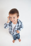 Little boy, speaking on the phone. Thumbs up Royalty Free Stock Photography