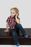 Little boy speaks by cell phone Royalty Free Stock Photos