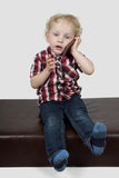 Little boy speaks by phone Royalty Free Stock Photography