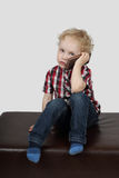 Little boy speaks by phone Stock Photography