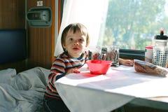 Little boy in speeding train Royalty Free Stock Photos
