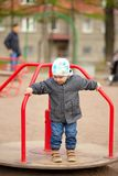 Little boy spinning on the roundabout Royalty Free Stock Photography