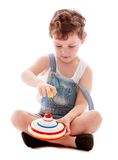 Little boy spins the spinner Royalty Free Stock Images