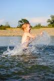 Little boy splashing water in river Royalty Free Stock Image