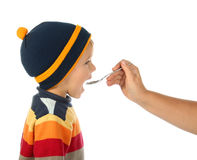 Little boy with spoon Royalty Free Stock Images