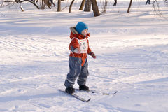 Little boy with a sports badge number is skiing. Royalty Free Stock Photos