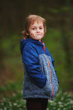 Little boy in spring forest with many flowers Royalty Free Stock Image