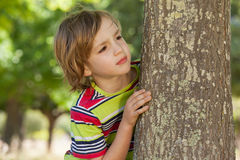 Little boy spying in the park Stock Photography