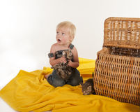 Little boy squeezing kitten Stock Image