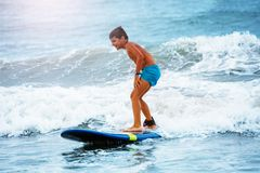 Little Boy Stand On The Surfboard Learn To Ride Royalty Free Stock Image