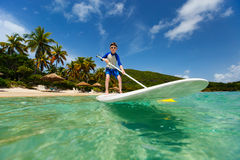 Little boy on stand up paddle board Stock Image
