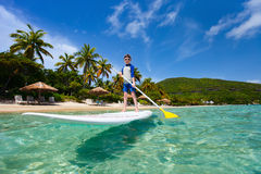 Little boy on stand up paddle board Stock Photo