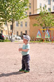 Little boy stand with a water bottle. In daylight Stock Photography
