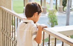 Little boy standing alone at balcony Royalty Free Stock Photos