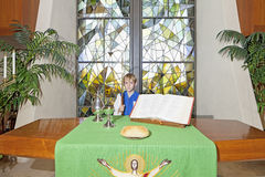 Little boy standing by the altar table Stock Photos