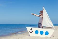 Little boy standing on the beach Stock Photo