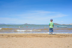 Little boy standing on the beach Royalty Free Stock Image