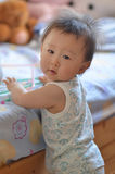 Little Boy Standing beside a Bed. Look back at camera, sweet and cute Stock Photography