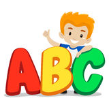 Little Boy Standing behind ABC Stock Image