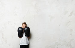 Little boy standing in boxing gloves and he ready Royalty Free Stock Image