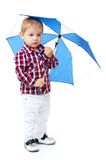Little boy standing colored umbrella . stock photos