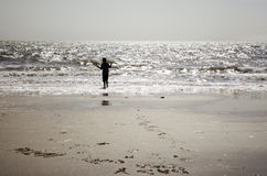 Little Boy Standing Facing the Sea Stock Image