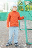 Little boy standing at goal Stock Images