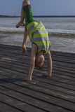 Little boy standing on his arms Royalty Free Stock Images