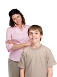 Little boy standing with his mother in background Royalty Free Stock Image