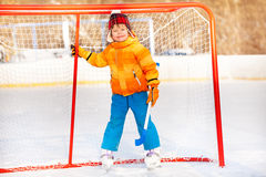 Little boy standing with hockey stick smiling Royalty Free Stock Photo