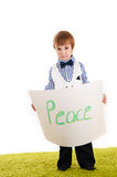 Little boy standing with the inscription Stock Photography