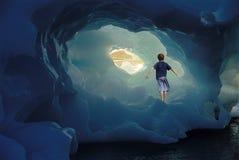 Little Boy Standing Inside Iceberg stock photos