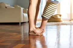 Little boy standing on mother's feet Royalty Free Stock Images