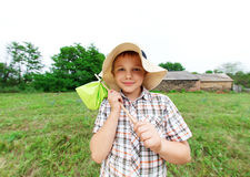 Little boy standing near country house Stock Image