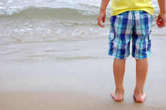 Little boy standing near the sea Royalty Free Stock Images
