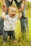 Little boy standing next to his father Stock Images
