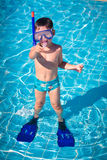 A little boy standing in a pool Stock Photography