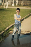 Little boy standing in puddle Stock Photo