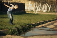 Little boy standing in puddle Royalty Free Stock Photo